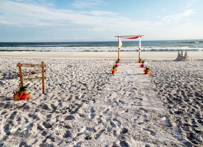 Guests will get some sand in their shoes at this ceremony!]